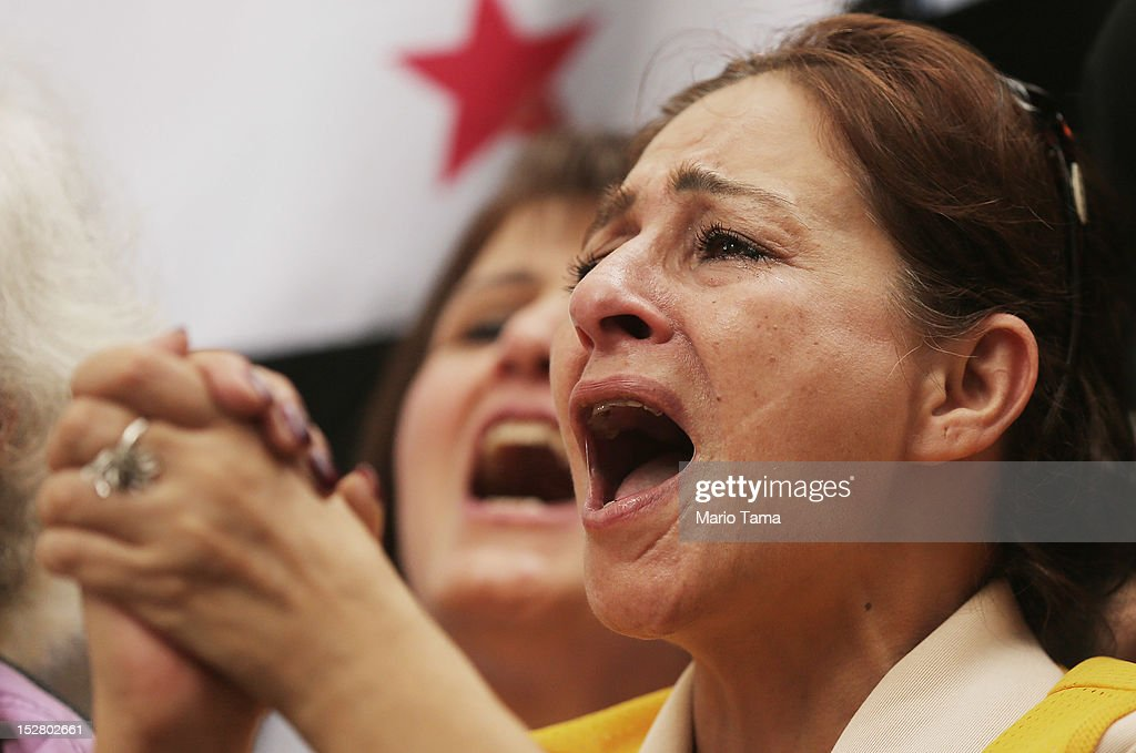 Protesters chant during a rally of groups opposing Iranian President Ahmadinejad's speech at the United Nations General Assembly on September 26, 2012 in New York City. Politicians including former New York Mayor Rudolph Giuliani, former House Speaker Newt Gingrich, former Homeland Security Secretary Tom Ridge, former New Mexico Governor Bill Richardson and former U.N Ambassador John Bolton spoke at the pro-democracy rally which also included Syrian pro-democracy protesters.