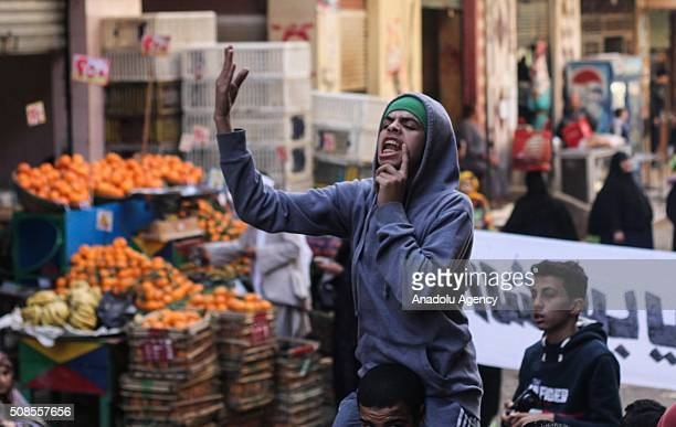 Protesters chant slogans and Rabia banners during a protest against Egyptian administration after the friday prayer at Nahiya village in Giza Egypt...