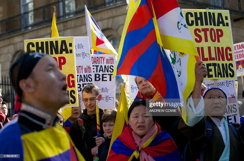 Protesters chant slogans and wave the Tibetan flag during a Free Tibet rally outside Downing Street in London on March 15, 2014. The annual march marks the anniversary of Tibetans' uprising against Chinese rule on March 10, 1959.
