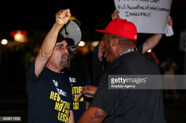 Protesters chant slogans during a protest on August 18 2014 for Michael Brown who was killed by a police officer on August 9 in Ferguson United...