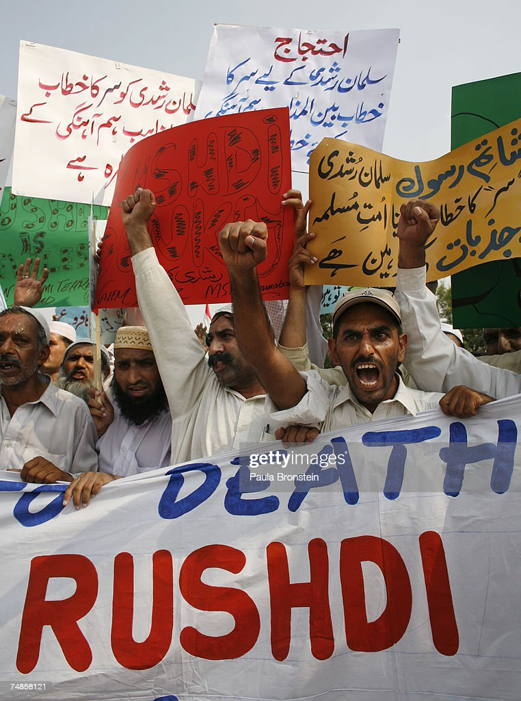 Protesters chant slogans to condemn Britain's knighting of the Indian-born author Salman Rushdie June 22, 2007 in Islamabad, Pakistan. Protests have been erupting in many cities in Pakistan after Rushdie received the honor from Britain's Queen Elizabeth II. A leading Iranian cleric stated today that the death sentence fatwa issued against Rushdie by Iran's leader 18 years ago over his book 'The Satanic Verses' is still valid. The author was forced into hiding for a decade after Khomeini issued the 1989 death sentence.