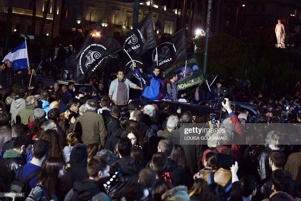 Protesters cheer as farmers on their tractors and vehicles arrive in front of the Greek parliament in Athens during their rally against pension reform, on February 12, 2016. Fears that Greece will exit the eurozone, a 'Grexit', could revive if Greek authorities do not come up with 'credible' reforms, notably on pensions, a senior IMF official said February 11. / AFP / LOUISA GOULIAMAKI