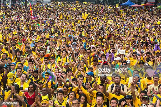Protesters cheer as they gather around the Merdeka Square during the Coalition for Clean and Fair Elections rally also known as Bersih in Kuala...