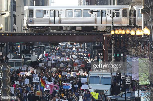 Protesters cheer at the Women's March on January 21 2017 in Chicago Illinois Thousands of demonstrators took to the streets in protest after the...