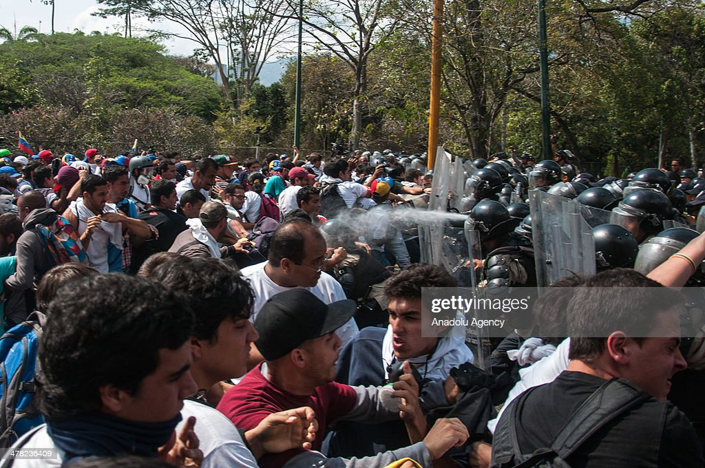 Protesters clash National Bolivarian Guard members during the anti-government protests in Caracas, Venezuela on March 12, 2014. Three people including a university student and a National Guard member, were shot death and several others injured on Wednesday during the anti-government protests in Venezuela.
