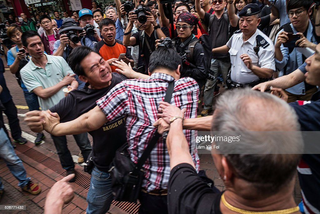 Protesters clash with local residents during protest in Sheung Shui on May 1, 2016 in Hong Kong, Hong Kong. Hundreds gathered in Hong Kong on Labor Day, demanding better workers' rights while voicing out their resentment against mainland travellers in Hong Kong.