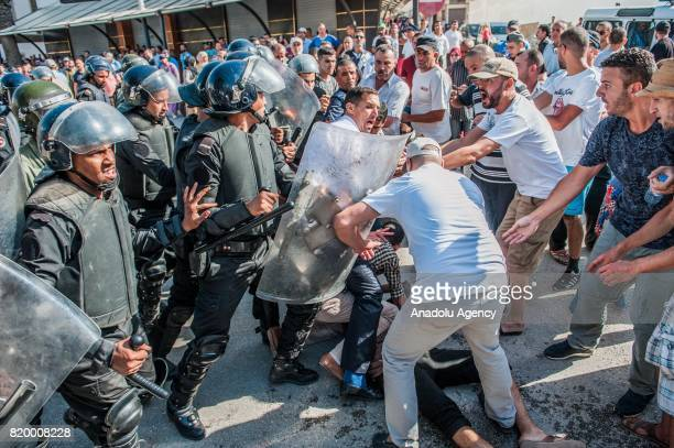 Protesters clash with Morocco security forces as they stage a demonstration continue over 7 months in Al Hoceima Morocco on July 20 2017 People...