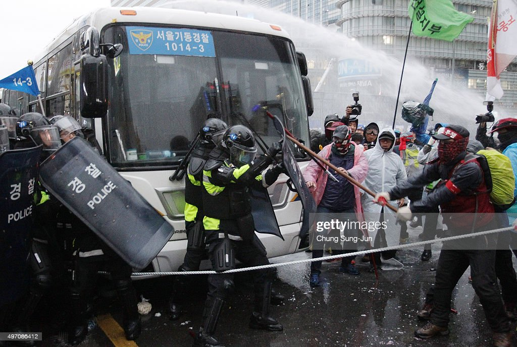 Protesters clash with police as they march towards Presidential house during a rally on November 14, 2015 in Seoul, South Korea. Tens of thousands of members of liberal civic groups including labor union workers and students across the nation gathered to protest against the introduction of new history textbook and other government policies.