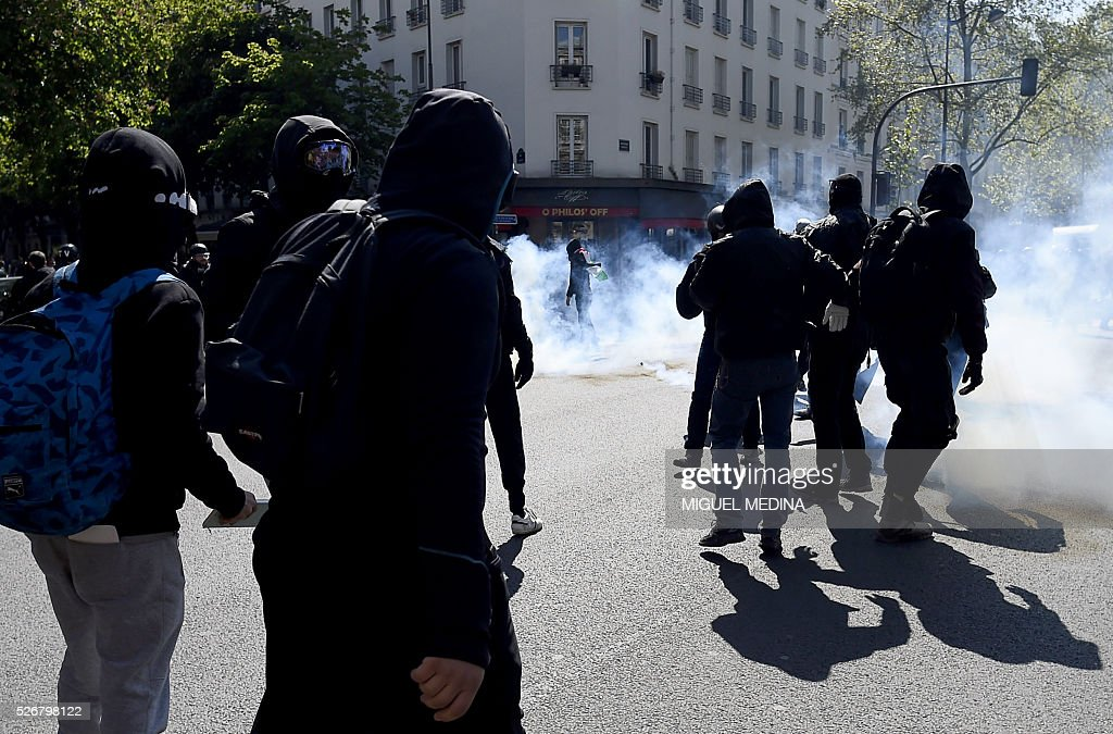 Protesters clash with police at a traditional May Day demonstration on May 1, 2016, in Paris.