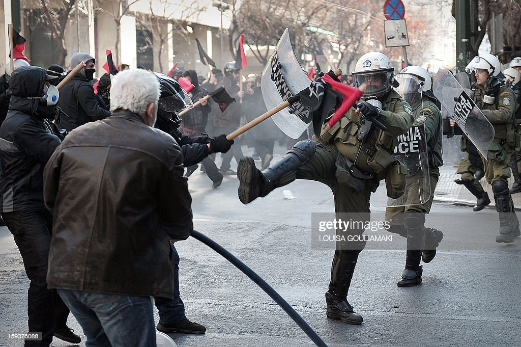 Protesters clash with police during a demonstration in Athens on January 12, 2013. Several thousand people demonstrated in Athens on January 12 to protest recent police operations against squatters in public buildings that have been condemned by the opposition. The protesters -- estimated by police at around 3,500 and nearly double that by media -- marched to the Athens court complex and police headquarters to demand the release of scores of individuals arrested in the sweeps. One of the central Athens buildings, a 19th-century former school, had been occupied for over two decades. The other is a stately block of flats whose former occupants include legendary soprano Maria Callas before her rise to fame. AFP PHOTO/ LOUISA GOULIAMAKI