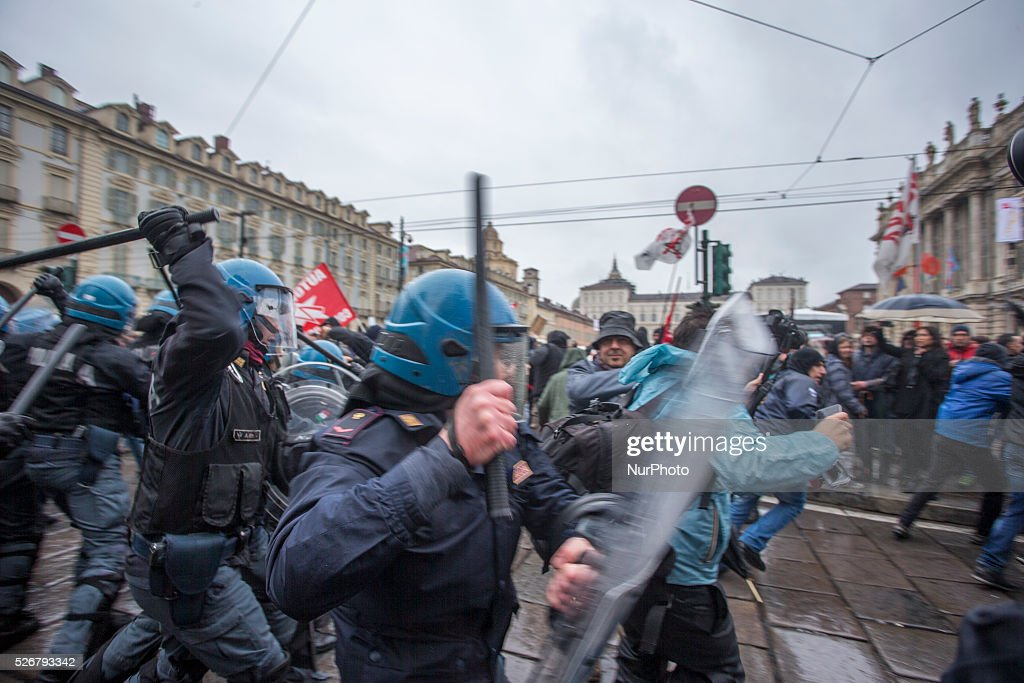Protesters clash with police during a demonstration on Labour day in Turin, Italy, on May 1, 2016