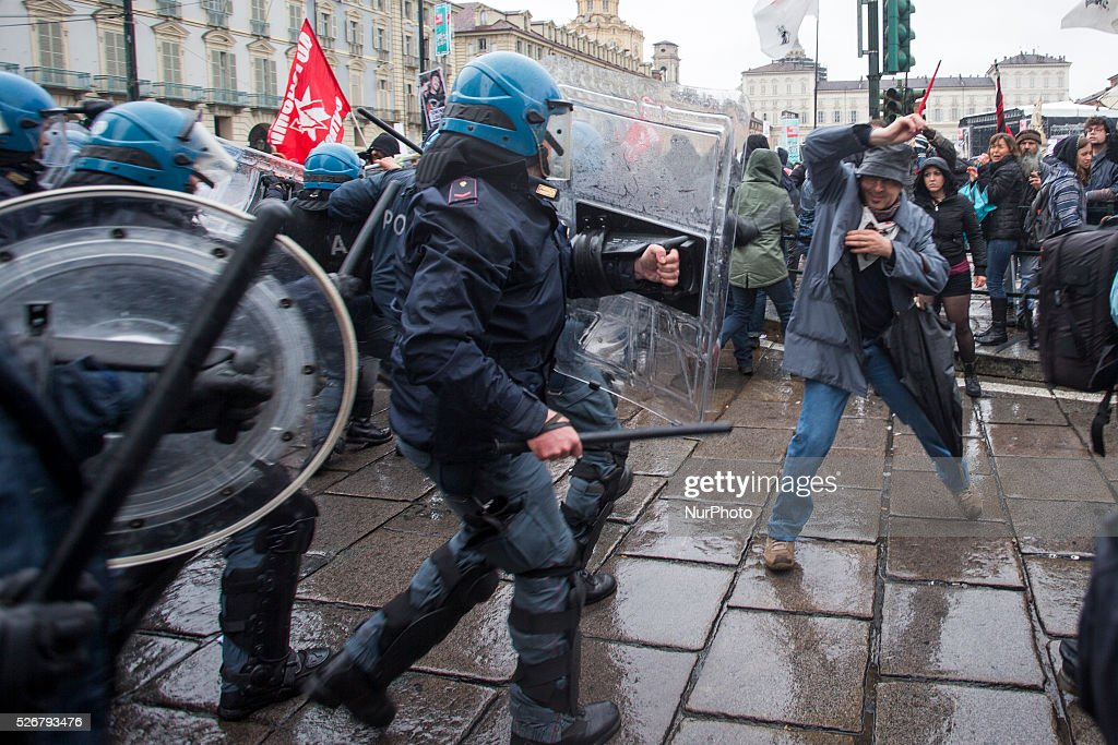 Protesters clash with police during a demonstration on Labour day in Turin Italy, on May 1, 2016..