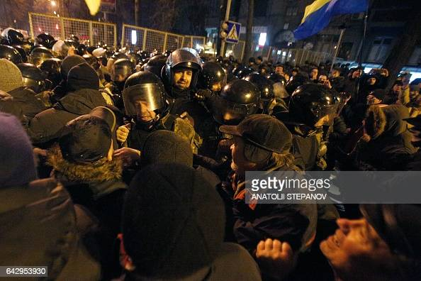 Protesters clash with police during a rally against trade with the occupied territories in Kiev on February 19 2017 More than a thousand protesters...