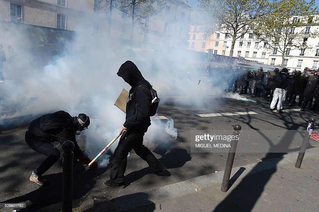 Protesters clash with police during a traditional May Day demonstration on May 1, 2016, in Paris.