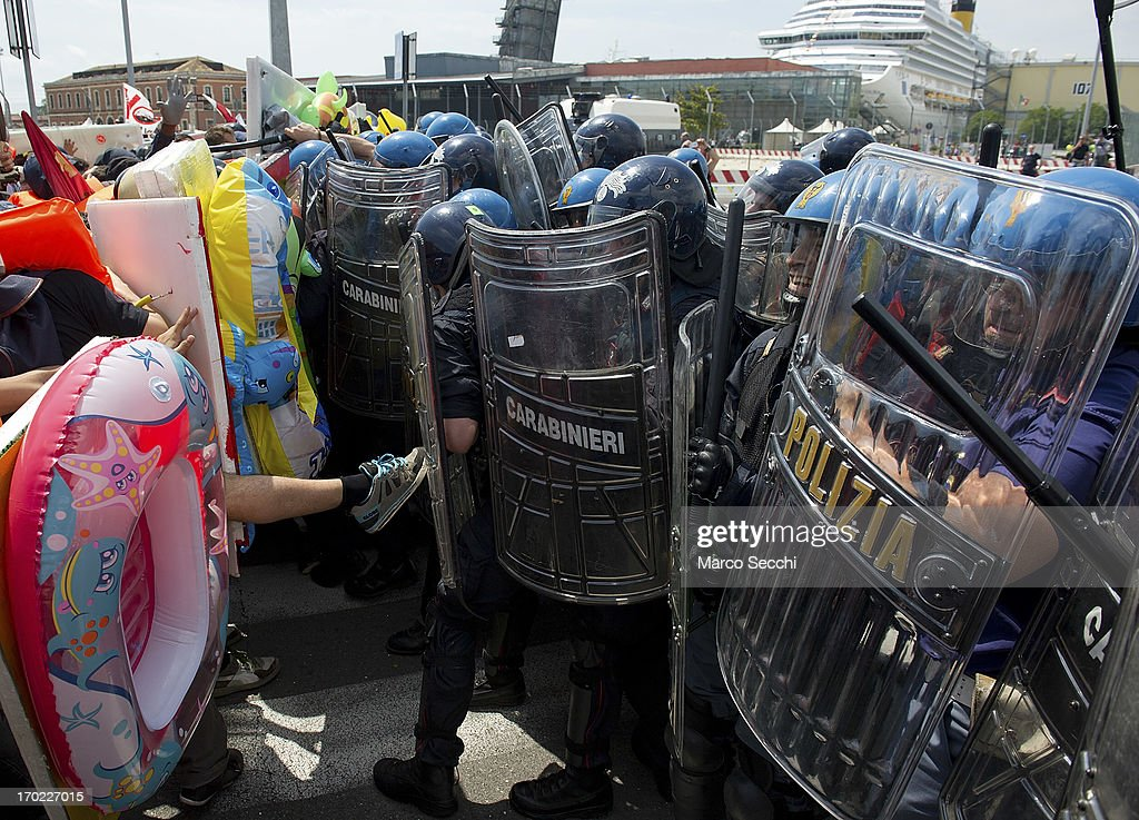 Protesters clash with police during the blockade of the Venice Tourist Port on June 9, 2013 in Venice, Italy. Three days of protests are being organised by Venetians and environmentalists, who are opposed to cruise ships crossing the St Mark's Basin.