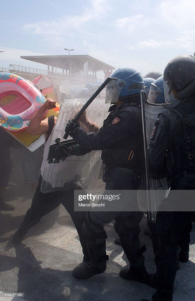 Protesters clash with police during the blockage of the Venice Tourist Port on June 9, 2013 in Venice, Italy. Three days of protests are being organised by Venetians and environmentalists, who are opposed to cruise ships crossing the St Mark's Basin.