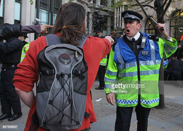 Protesters clash with police in Threadneedle St in London's financial district as global leaders attend the G20 Summit on April 2 2009 in London...