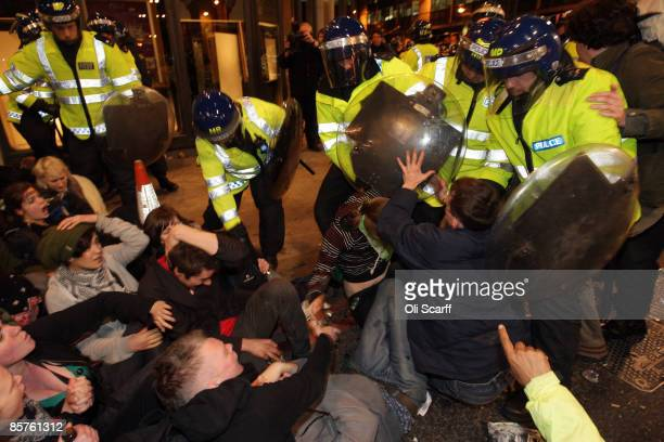 Protesters clash with police near the RBS headquarters during a demonstration by anticapitalist and climate change groups April 1 2009 in London...