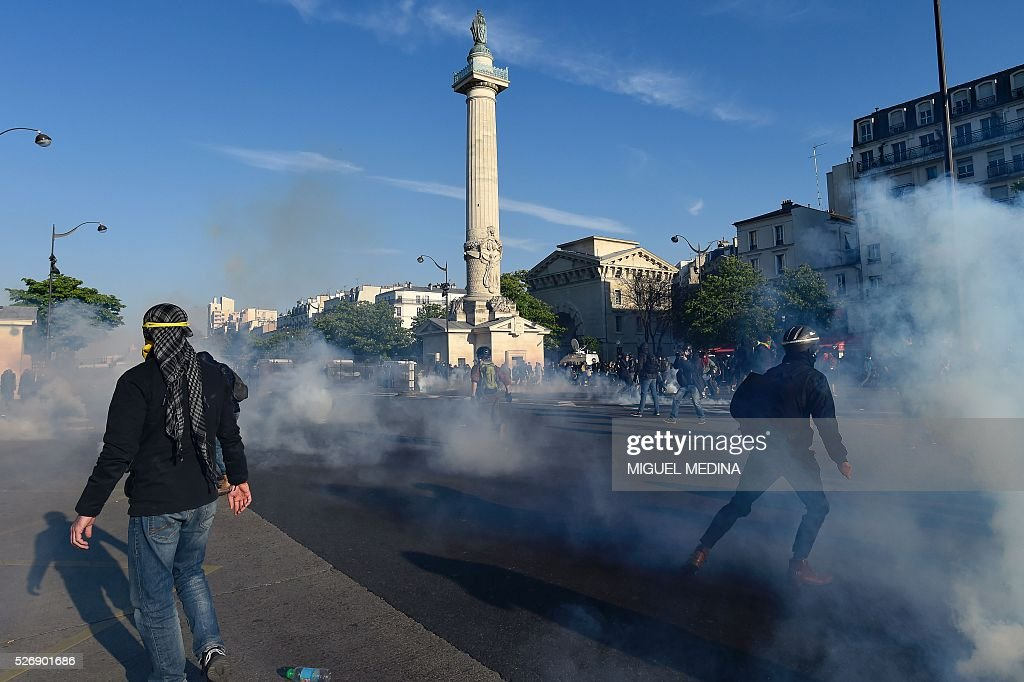 Protesters clash with police on the Place de la Republique at a traditional May Day demonstration on May 1, 2016, in Paris.