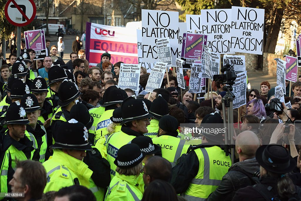 Protesters clash with police outside Cambridge University's Student Union as Marine Le Pen, the leader of the French far-right 'Front National' party, prepares to address the Union's debating society on February 19, 2013 in Cambridge, England. Mrs Le Pen, who has been an MEP since 2004 and is the daughter of former Front National leader Jean Marie Le Pen, is expected to speak about the future of the European Union and French politics. Although her appearance at the Union has provoked controversy with the anti-fascist group 'Unite Against Fascism'.