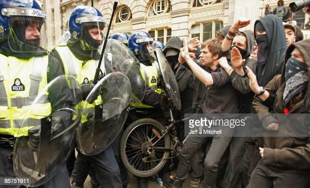 Protesters clash with police outside the Bank of England as anticapitalist and climate change activists demonstrate in the City of London on April 1...