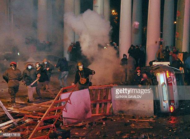 Protesters clash with riot police on January 19 2014 during an opposition rally in the centre of the Ukrainian capital Kiev in a show of defiance...