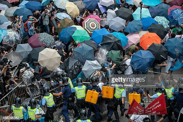 Protesters clash with riot police on September 28 2014 in Hong Kong Thousands of people kicked off Occupy Central by taking over Connaught Road one...