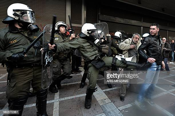 Protesters clash with riot police outside the Labour Ministry in Athens on January 30 2013 Police were called in on Wednesday to dislodge around 30...