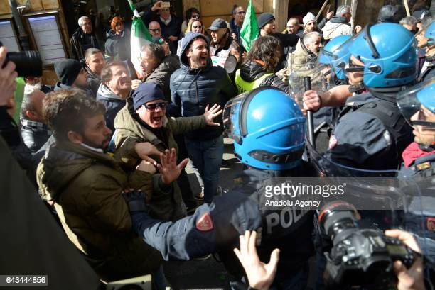Protesters clash with security forces during taxi drivers' strike to protest the amendment on appbased car transport company Uber in Rome Italy on...
