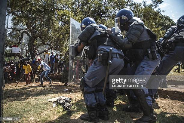 Protesters clash with security forces on the south lawn of the Union Building in Pretoria during a protest against university fee hikes on October 23...