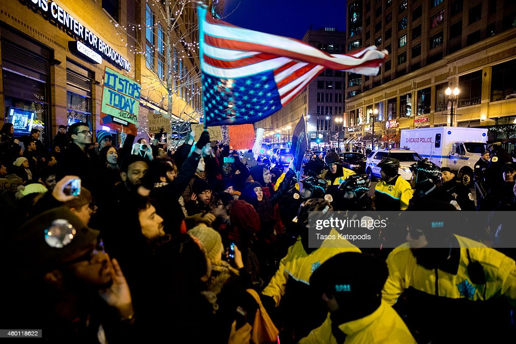 Protesters clash with the Chicago police in the street after recent grand jury decisions in police-involved deaths on December 7, 2014 in Chicago, Illinois. Protests have errupted in cities across the nation after two grand juries decided not to indict the police officers involved in the deaths of Michael Brown in Ferguson, Missouri and Eric Garner in New York City.