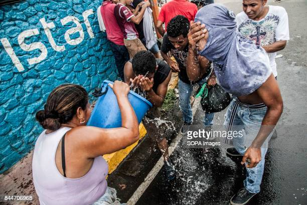 CHICHIGALPA CHINANDEGA NICARAGUA Protesters clean their eyes from the police pepper spray as demonstrations and clashes with the police have become...