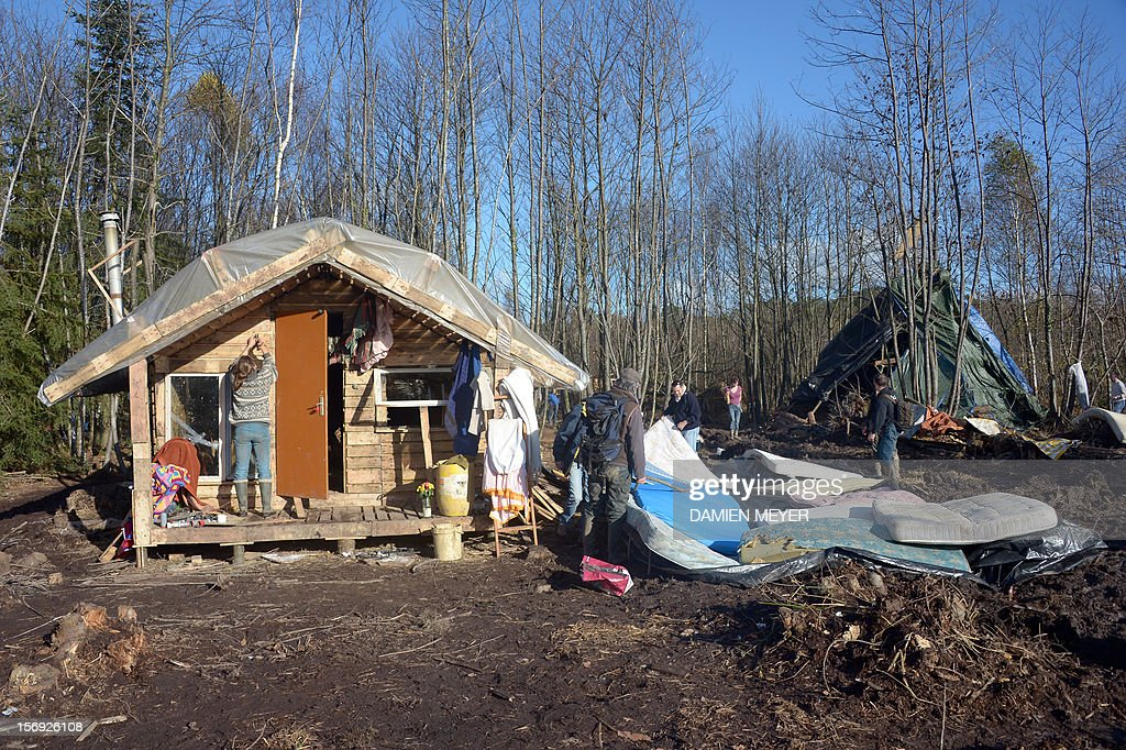 Protesters clean their wooden houses after re-occupying a protected swampland on November 25, 2012 in Notre-Dame-des-Landes, near Nantes in western France, one day after their eviction and clashes with anti-riot policemen. The airport, which is scheduled to replace the current airport at Nantes in 2017, is a pet project of Socialist Prime Minister Jean-Marc Ayrault, who was the city's mayor from 1989 until this year.