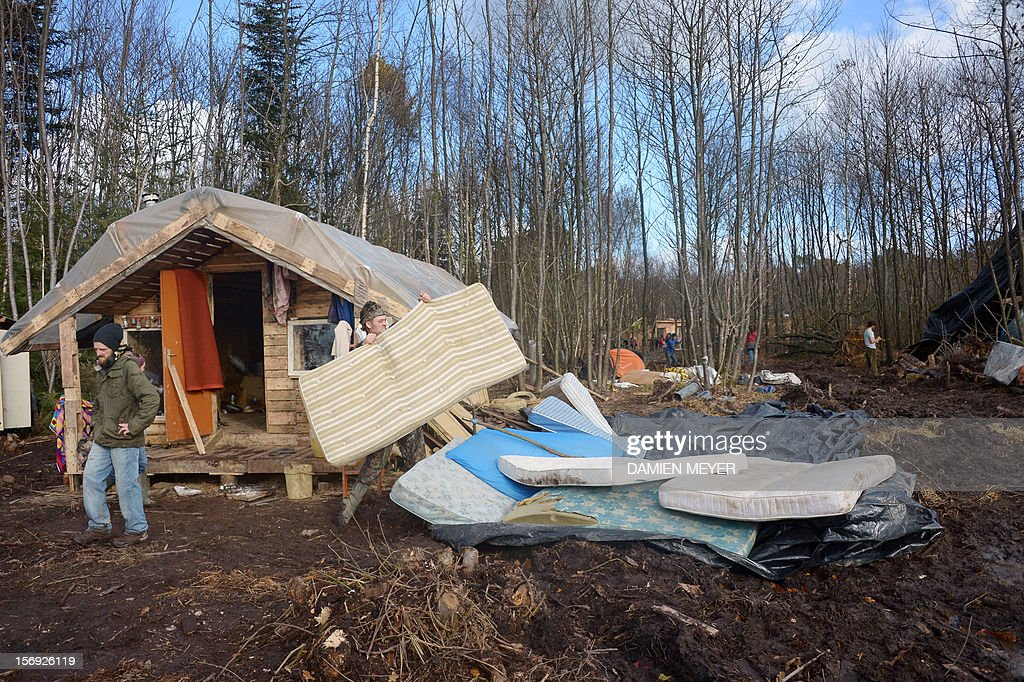 Protesters clean their wooden houses after re-occupying a protected swampland on November 25, 2012 in Notre-Dame-des-Landes, near Nantes in western France, one day after squattres' eviction and clashes with anti-riot policemen. The airport, which is scheduled to replace the current airport at Nantes in 2017, is a pet project of Socialist Prime Minister Jean-Marc Ayrault, who was the city's mayor from 1989 until this year.