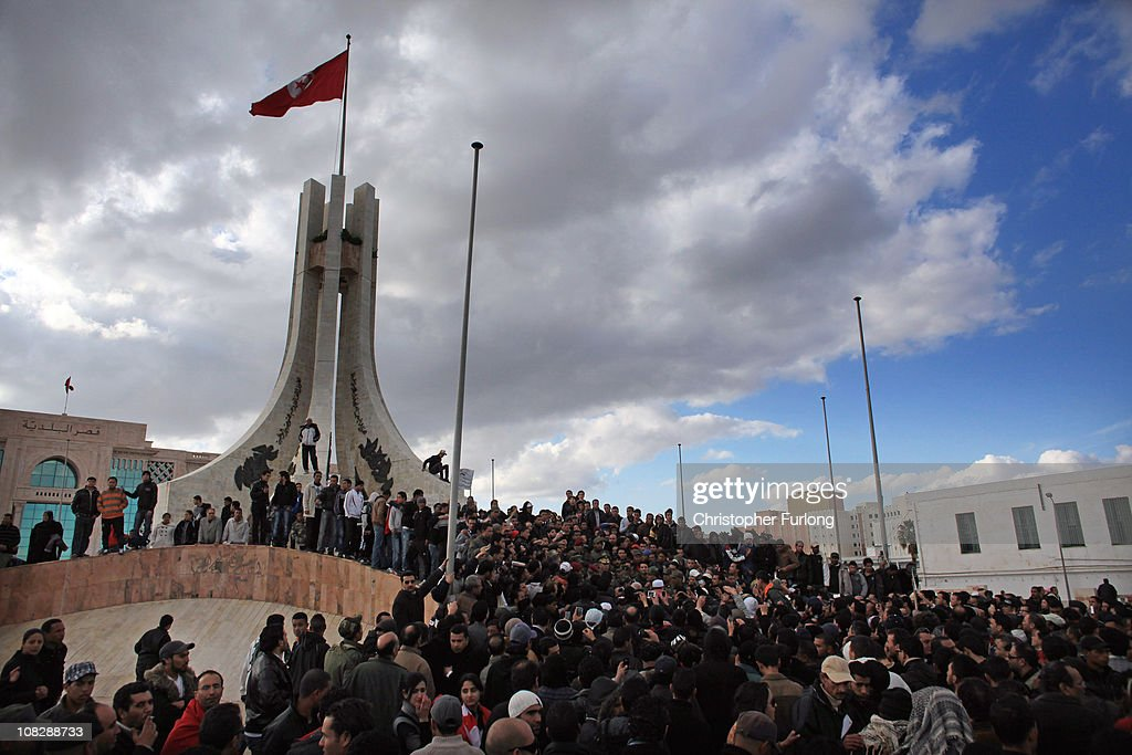 Protesters climb on to the City Hall Monument near the prime minister's office to listen to Rachid Ammar The Chief of the General Staff of the...
