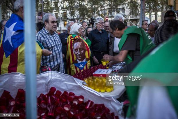 Protesters collect candles before taking part in a candlelit vigil to demand the release of imprisoned seperatist leaders Jordi Sanchez head of the...