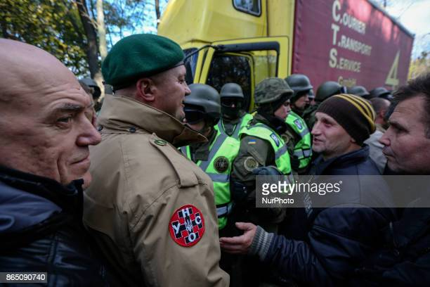 Protesters confront with the police which block the vehicle with soundamplifying facilities in Kyiv Ukraine Oct22 2017 Dozens Ukrainians set up a...