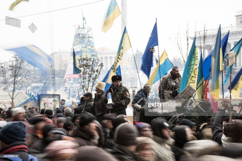 Protesters control the flow of people in and out Maidan Square on December 15, 2013 in Kiev, Ukraine. The anti-government protesters are demanding the resignation of the government after Ukrainian President Victor Yanukhovych angered many by refusing to sign an agreement that would strengthen cooperation with the European Union and instead keep ties with Russia.