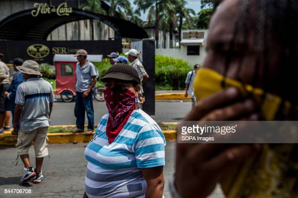 CHICHIGALPA CHINANDEGA NICARAGUA Protesters cover their faces with scarfs as demonstrations and clashes with the police have become too common in...