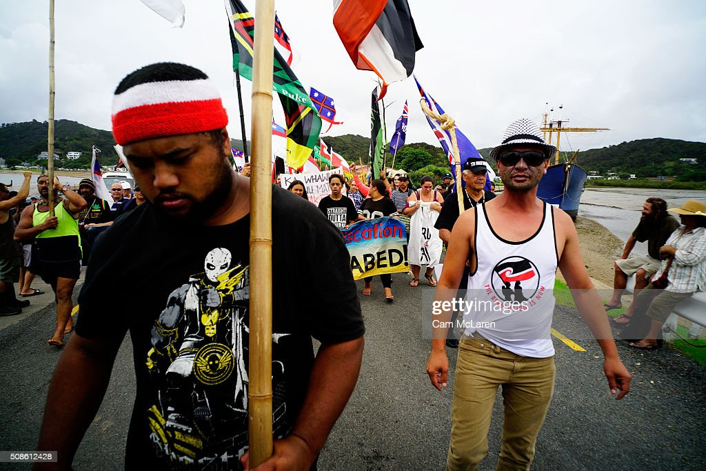 Protesters cross the bridge on February 6, 2016 in Waitangi, New Zealand. The Waitangi Day national holiday celebrates the signing of the treaty of Waitangi on February 6, 1840 by Maori chiefs and the British Crown, that granted the Maori people the rights of British Citizens and ownership of their lands and other properties.