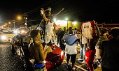 Protesters dance on the hood of a car as traffic backs up near the convenience store where Alton Sterling was shot and killed July 6 2016 in Baton...