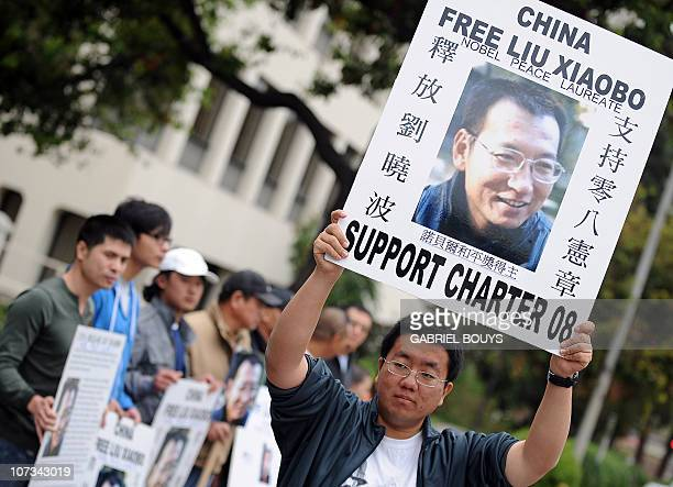 Protesters demand the release of jailed Nobel Peace laureate Liu Xiaobo in front of the Chinese Consulate in Los Angeles California on December 5...