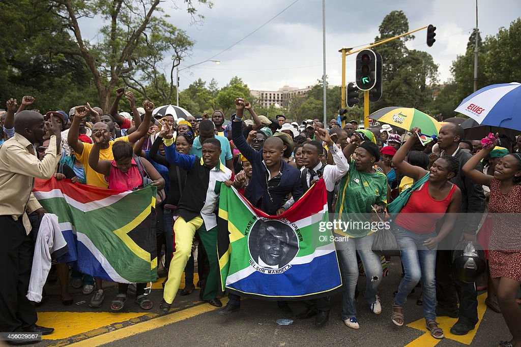 Protesters demonstrate after being refused entry by police to view former South African president Nelson Mandela as he lies in state for a final day at Union Buildings on December 13, 2013 in Pretoria, South Africa. Over 60 heads of state have travelled to South Africa to attend a week of events commemorating the life of former South African President Nelson Mandela. Mr Mandela passed away on the evening of December 5, 2013 at his home in Houghton at the age of 95. Mandela became South Africa's first black president in 1994 after spending 27 years in jail for his activism against apartheid in a racially-divided South Africa.