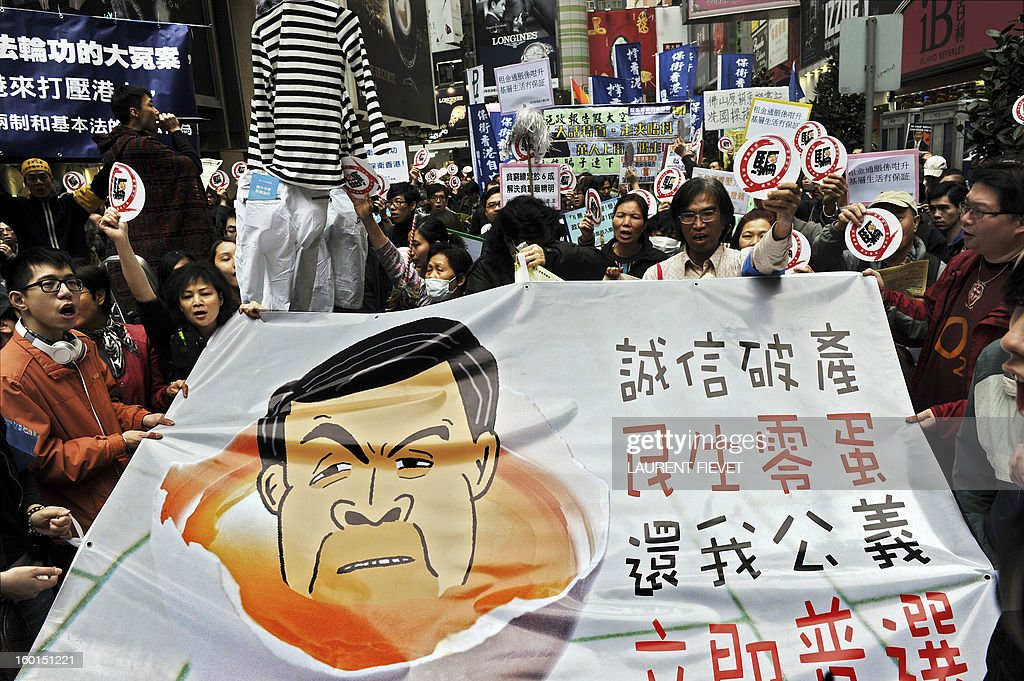 Protesters demonstrate against Hong Kong Chief Executive Leung Chun-ying during a march in Hong Kong on January 27, 2013. Around a thousand protesters took to the streets of Hong Kong to rally against its leader, saying his policies lack commitment and offer nothing new in improving livelihood issues.