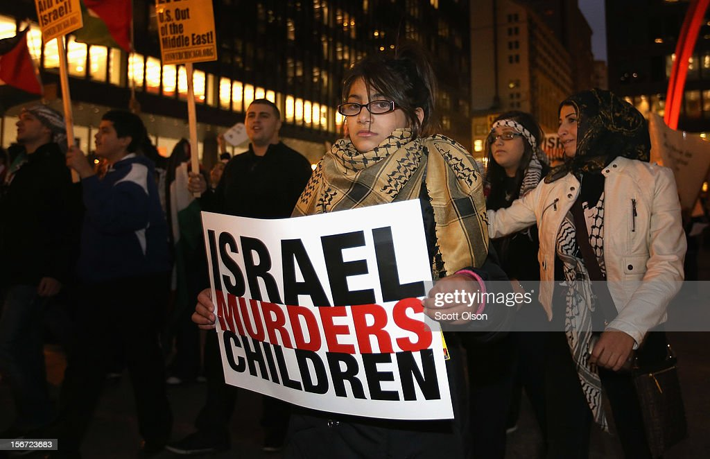 Protesters demonstrate against Israeli attacks on Gaza on November 19, 2012 in Chicago, Illinois. Several hundred people joined the protest which started with a rally in the Federal Building Plaza and finished with a march through the Loop during rush hour.