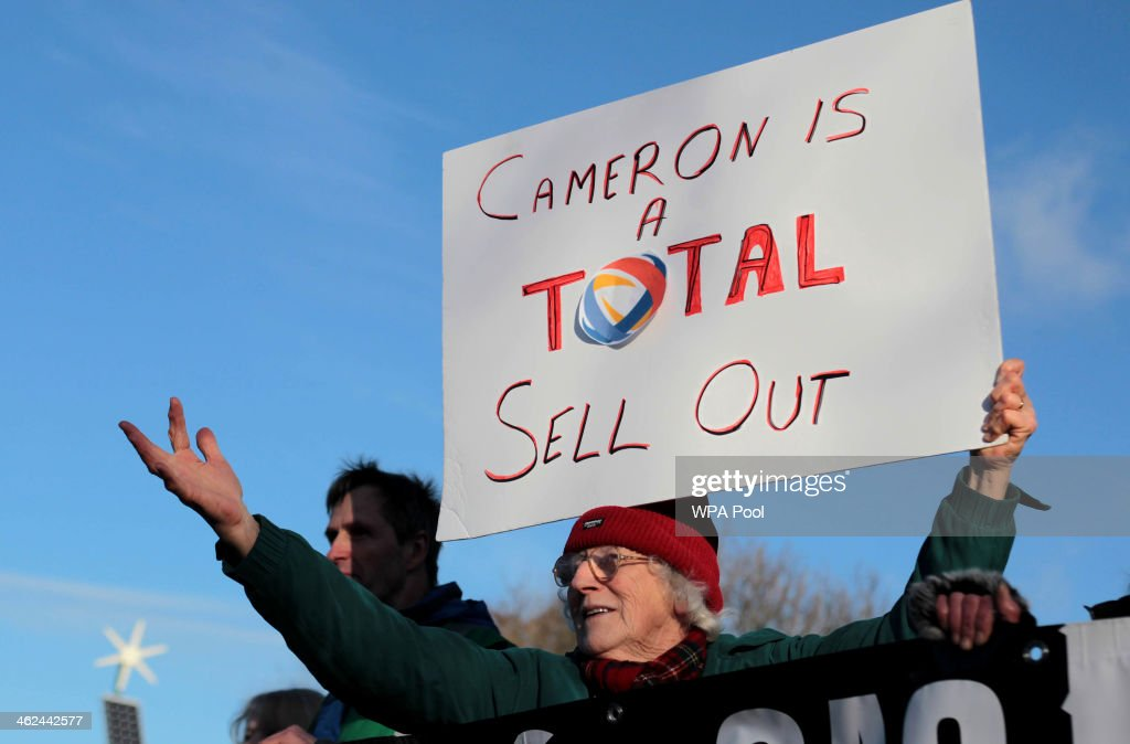 Protesters demonstrate as Prime Minister David Cameron visits the Total Oil Depot shale drilling site in Gainsborough Lincolnshire on January 13 2014...