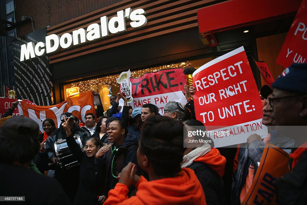 Protesters demonstrate at a McDonald's in Midtown Manhattan on December 5, 2013 in New York, United States. Protesters staged events in cities nationwide, demanding a pay raise to $15 per hour for fast food workers and the right for them to unionize.