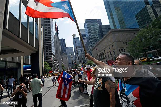 Protesters demonstrate at the Puerto Rican debt talks outside Citibank Inc headquarters on Park Avenue in New York US on Monday July 13 2015 Puerto...