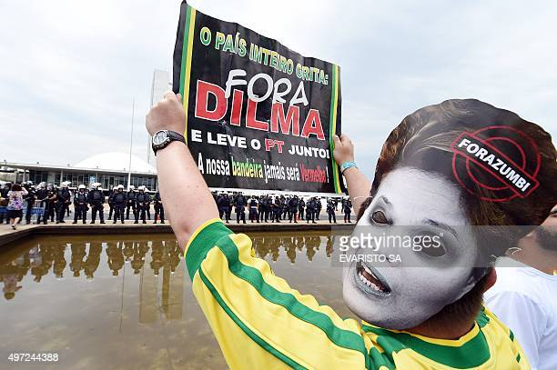 Protesters demonstrate calling for the impeachment of Brazilian president Dilma Rousseff and blaming her for a steep economic downturn in Brazil in...