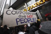 Protesters demonstrate in front of a Wells Fargo bank branch during an Occupy Wall Street 'Shut Down the Corporations' protest on February 29 2012 in...